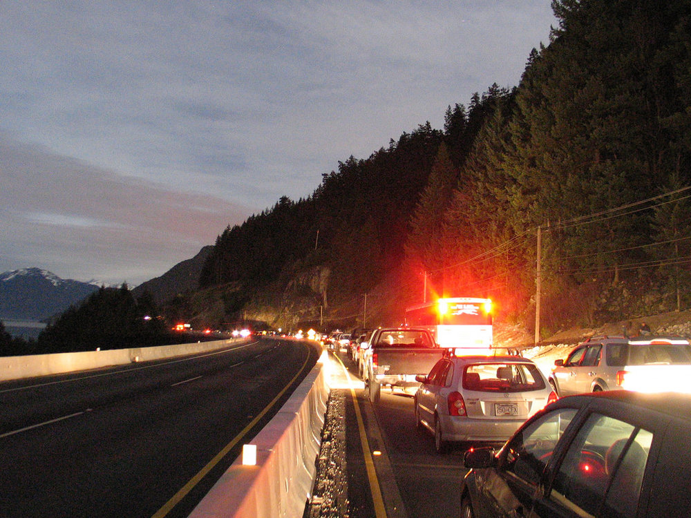 Traffic backs up on the Sea to Sky highway.  Photo via flickr
