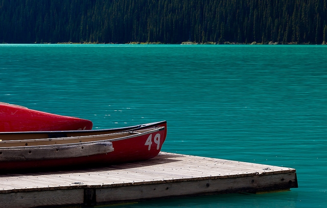 Canoes docked on Lake Louise at Banff National Park via flickr