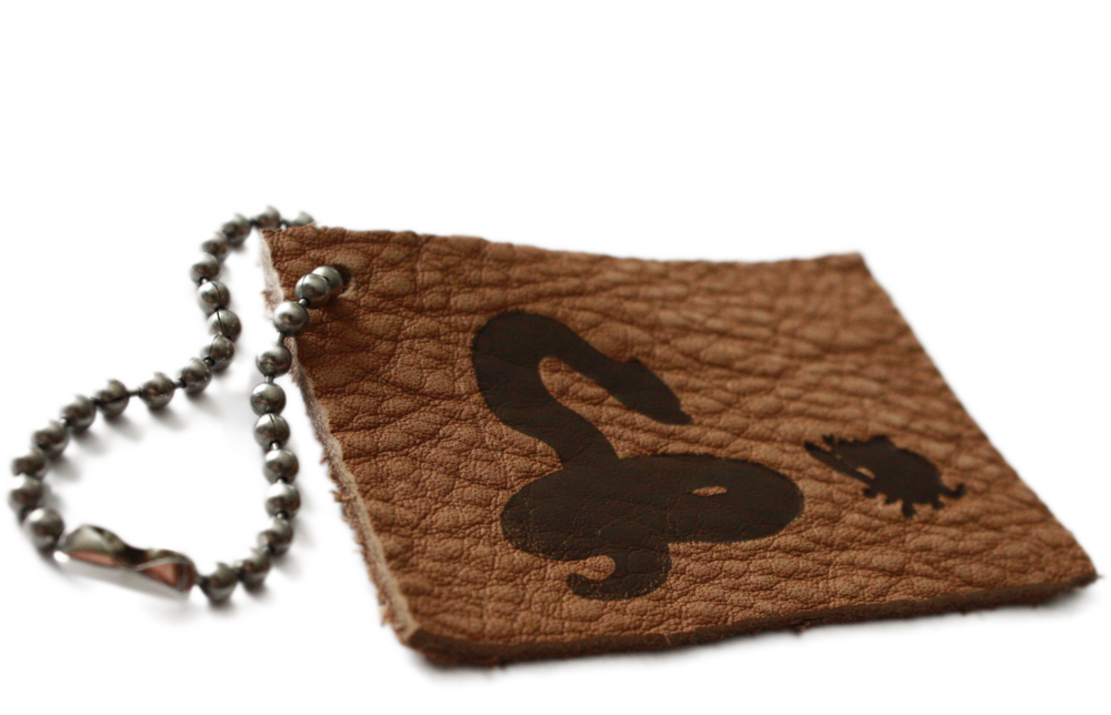 Hand-made genuine leather keychains, branded with the Forthright snake and mouse logo.