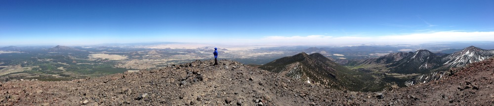 A 180 degree panorama from the summit of Humphreys Peak. The left side of the photo looks northwest, toward the Grand Canyon, some 70 miles away.  The right side looks to the southeast, into the upper basin of the San Francisco peaks.