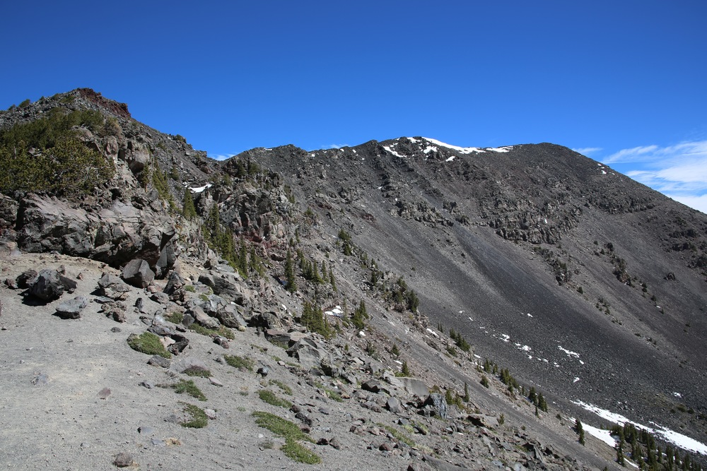 The summit ridge of Humphreys Peak, taken from the saddle at 11,800 feet.  The hike from the saddle to the summit is rocky and sometimes steep.  The ridge is exposed to strong westerly winds, which can sometimes be an adventure. Even in summer, come prepared with warm clothes and gloves.