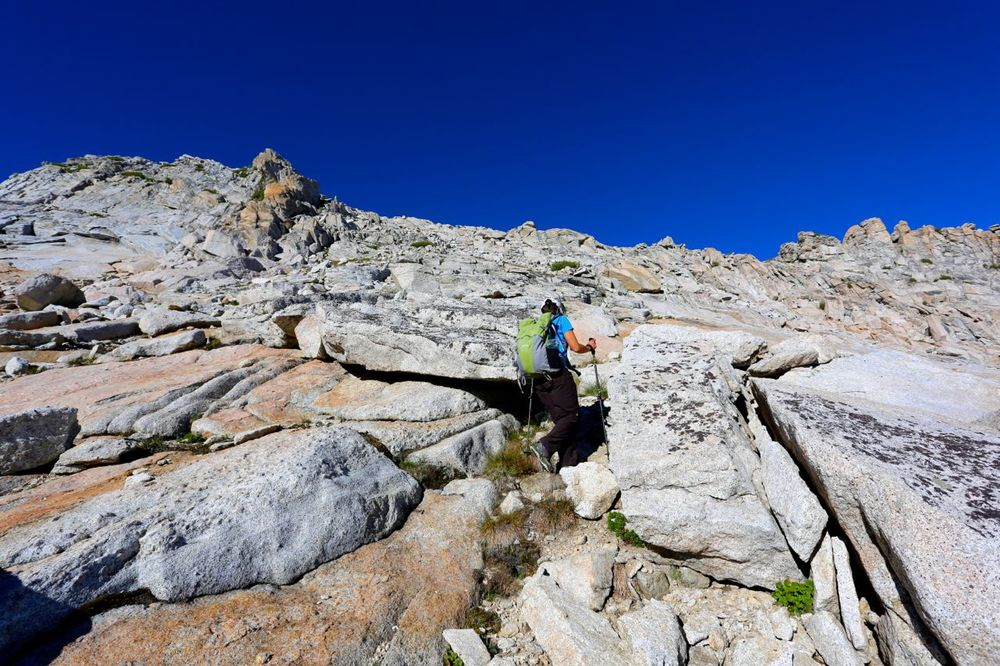 Nearing the ridge, Karen picks her way through slabs and up towards the crux gully.