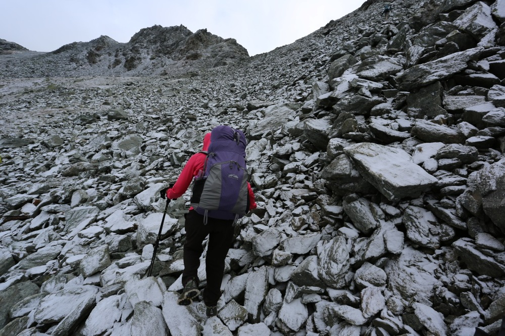 Our final pass was hit with early snow the night before we hiked over its summit.  Here Karen ascends near the top of the Augstbordpass.