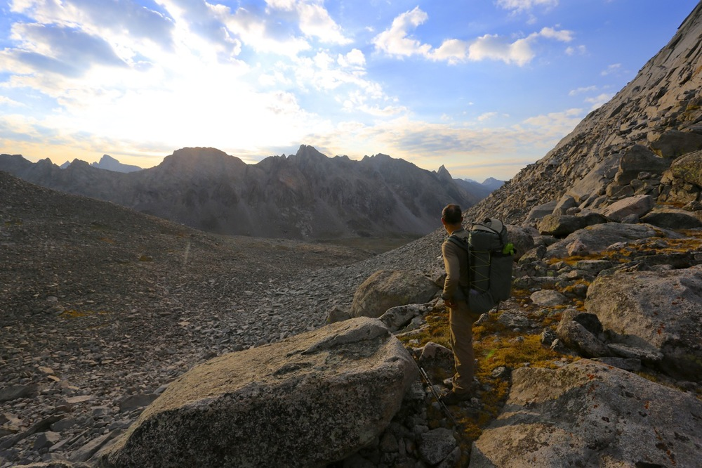 Alan looks into the East Fork Valley and the rising sun from the pass between Mount Bonneville and Raid Peak