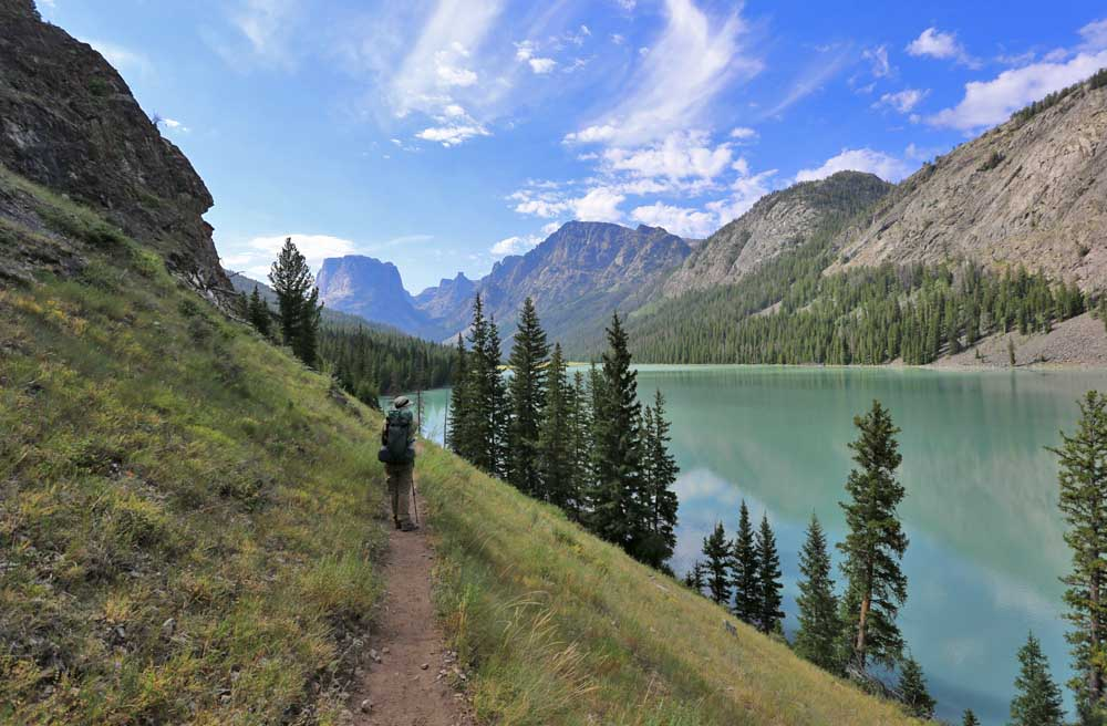Trail along the eastern shore of the turquoise colored Green River Lakes. Iconic Squaretop Mountain looms in the distance.