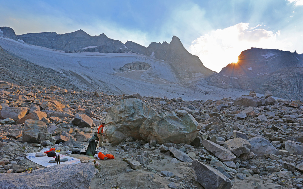 Camp in the talus below Knife Point Glacier. Indian Pass lies in the obvious notch left of the setting sun.