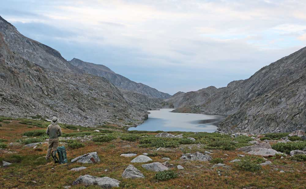 Long Lake (Lake 10,683). The route follows the shore and slope on the left (eastern) side of the lake.