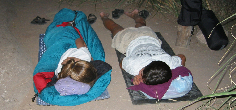 After a lazy day along Monument Creek we tried to get to sleep early in order to rise at 130 am and start hiking across the Tonto Plateau. Note Karen's ultra lightweight sleep system (on the right).  It is so warm in the canyon in summer that in most locales a sleeping bag is unnecessary and unwelcome. A better system might be to bring an old cotton sheet and then throw on a light jacket or pants if it cools down a bit.
