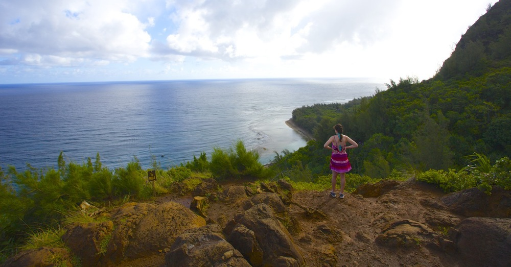 Early in the hike after some climbing, Megan looks back toward the east and Ke'e Beach. The beach is out sight below Megan.