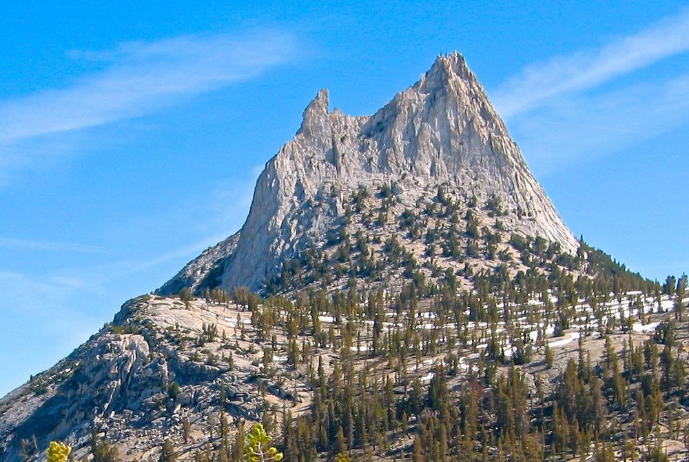 The classic route on the southeast buttress of Cathedral Peak (10.990 feet) ascends near the right hand skyline in the photo.  This photo was taken from the west, near Cathedral Lakes.  The smaller summit on the left is Eichorn Pinnacle.