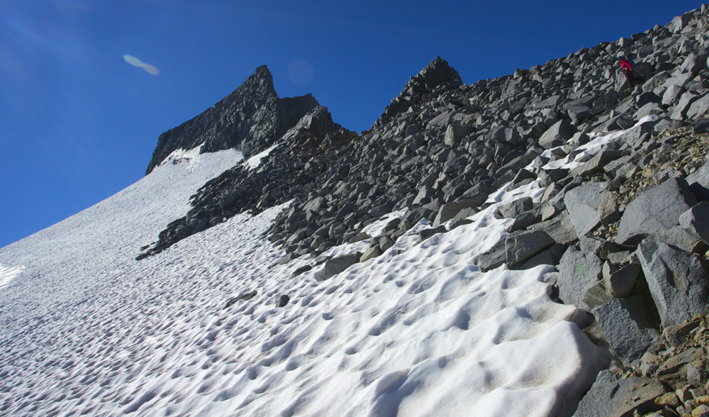 Karen on the northwest ridge of Mount Lyell. Low snow means more rock is exposed on the steep upper ridge, making the route more difficult than in years past when the glacier or winter snow was higher on the mountain.