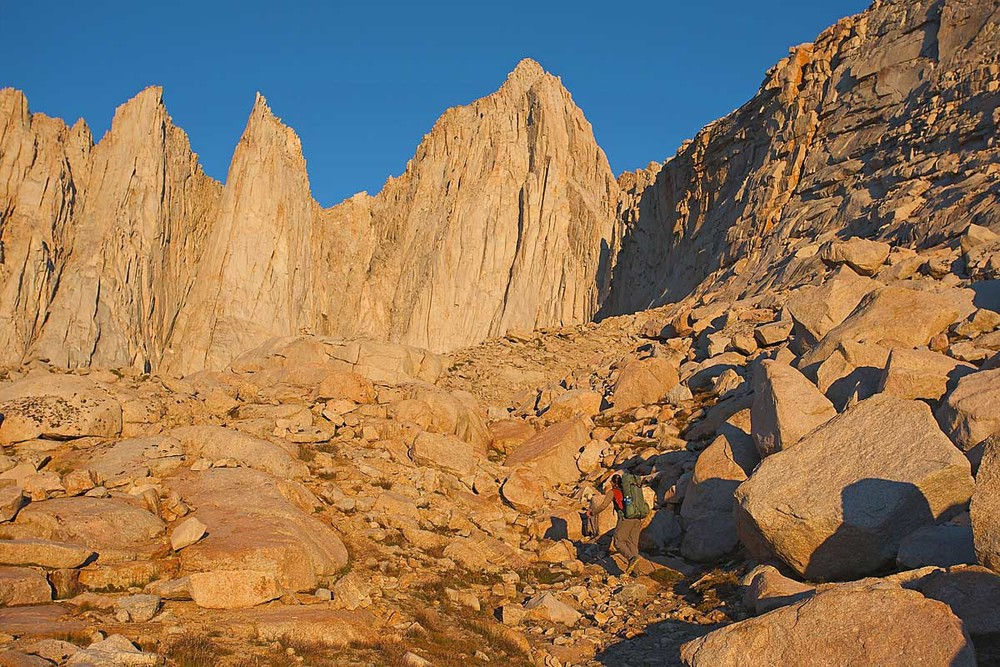 First light approach to the Mount Whitney massif. Mount Whitney in center. To the left are Keeler Needle and Day Needle.
