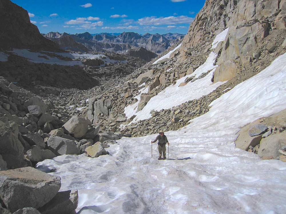 Ascending a late season snowfield en-route to Mt. Sill.
