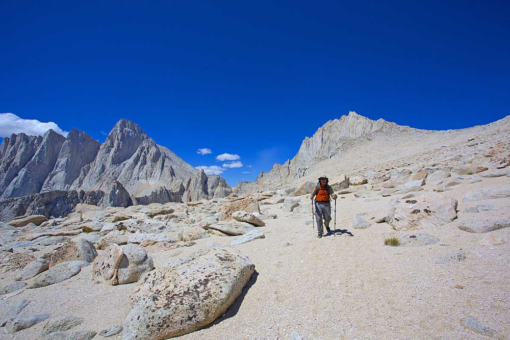 Alan begins the descent from Russell-Carillon Col down to Upper Boy Scout Lake. The col is at far right, Mount Russell is directly behind Alan. Mount Whitney is the highest (rightmost) peak of the three peaks on the left.