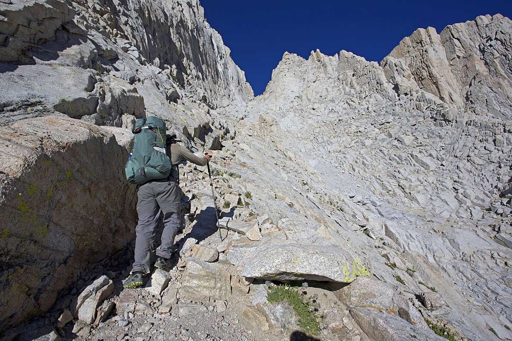 Alan slogs his way up steep, loose scree on the Mountaineer's Route. The climb of Whitney and traverse across its southern ridge is a highlight of the SoSHR.
