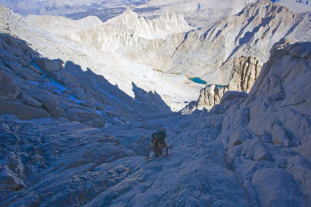 The final class 3 portion of the Mountaineer's Route to the summit of Mt. Whitney. It had snowed on Mt. Whitney the week before with an ensuing melt and freeze cycle. This left the final 300 ft of the Mountaineer's Route quite icy and a bit more entertaining. The easier route up the notch (to the left of Alan in the photo) is completely covered in a sheet of ice (verglas). This forced us up on steeper and more difficult rock. Fortunately we were able to find non-icy rock and did not need crampons or ice axes.