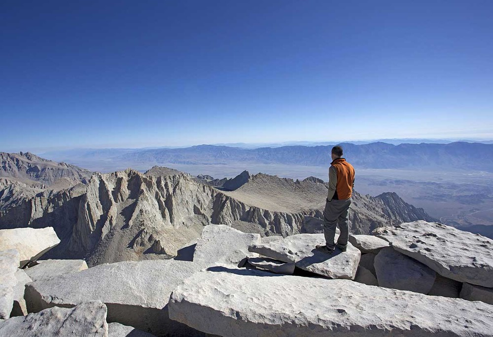Alan looks off to the northeast from the summit of Mount Whitney.