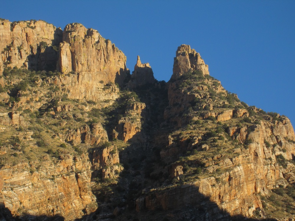 Iconic Finger Rock in the Santa Catalina Mountains north of Tucson is visible from much of town. It looms 4000 vertical feet above downtown Tucson.  Balanced like a precarious pencil and surrounded by other cliffs, it's probably the most striking and commonly recognized landmark in southern Arizona.  The more blunt formation right of Finger Rock is known as The Guard.