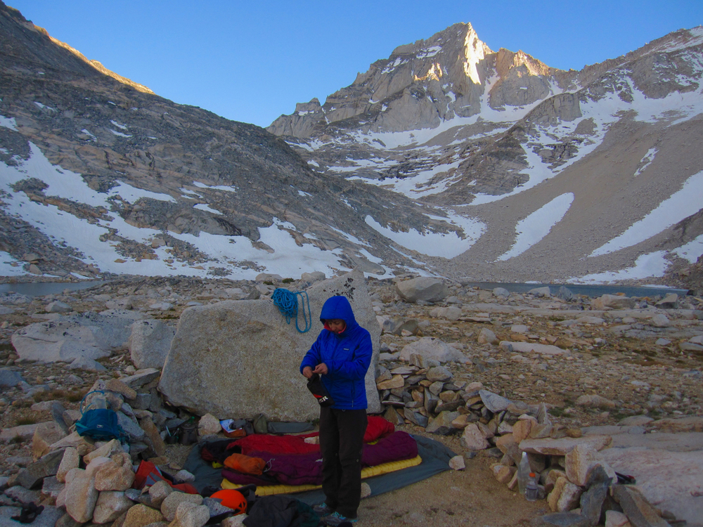 Our campsite at Dade Lake was pounded by high winds all afternoon.  We found this site where we set up in the lee of this boulder. The northeast ridge of Bear Creek Spire takes a line just left of the sun/shade line on the upper face of the peak.