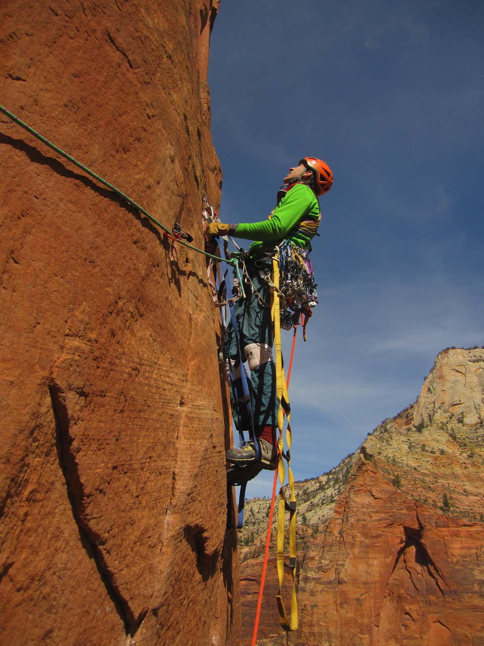 Don starts up the third pitch bolt ladder. This pitch has a few mandatory free moves, but goes pretty easily and quickly. The pitch traverses about 50 feet or more. If you are hauling a bag, be prepared to lower the bag out. After this pitch, the hauling is simple and easy for the rest of the route.
