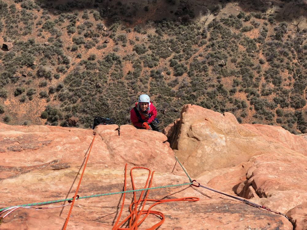 Karen arriving at the final belay. The section pictured here is the final 5.7 free section at the top of the route.