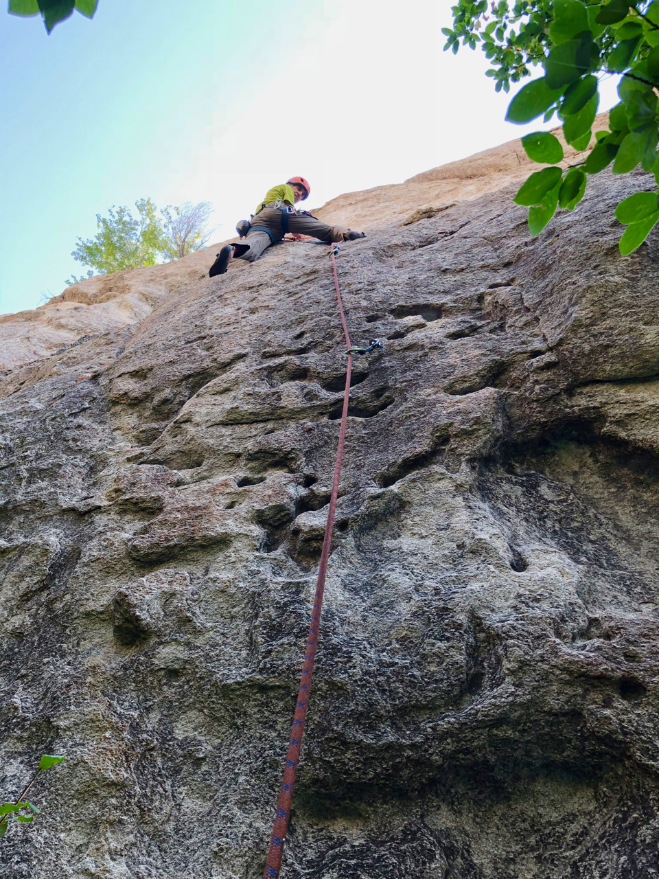 Dynamo Hum (5.10c). A good example of the unusual pocketed granite found on some routes.
