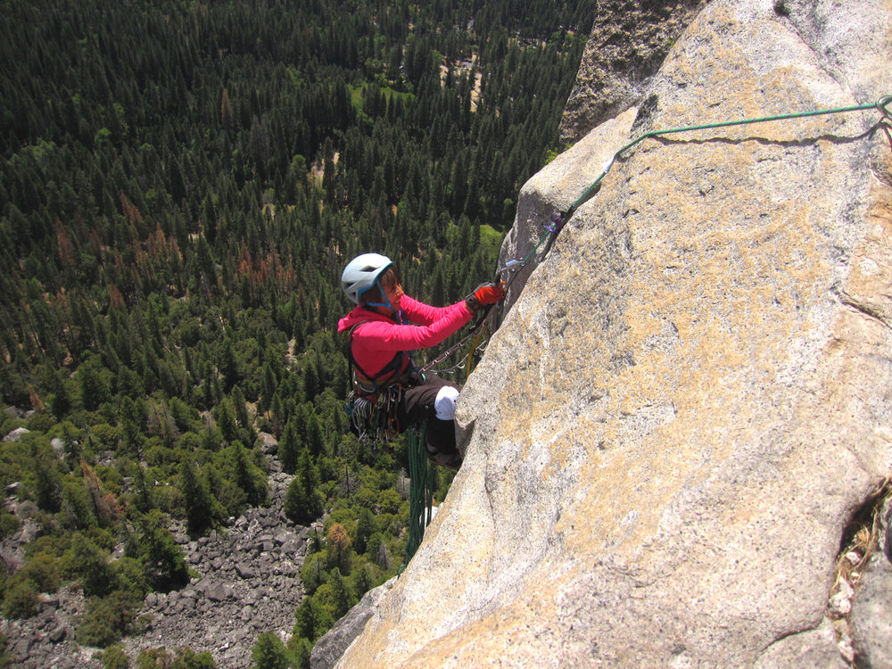Karen cleaning the third pitch on the Prow, Washington Column, Yosemite Valley.