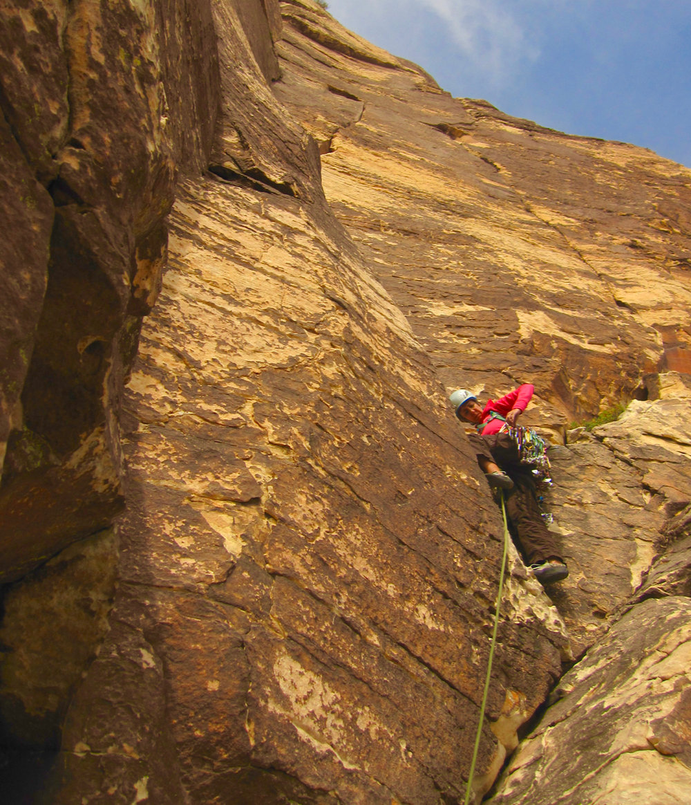 Karen leading the second pitch of Frogland. This is a classic moderate route in Black Velvet Canyon, Red Rocks, Nevada.