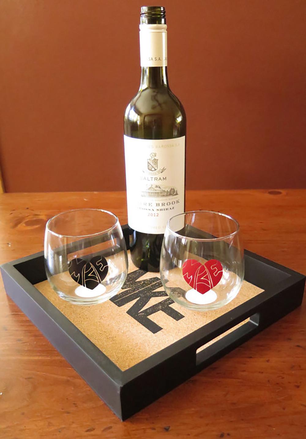 MKE cork serving tray $50,MKE love glasses $12