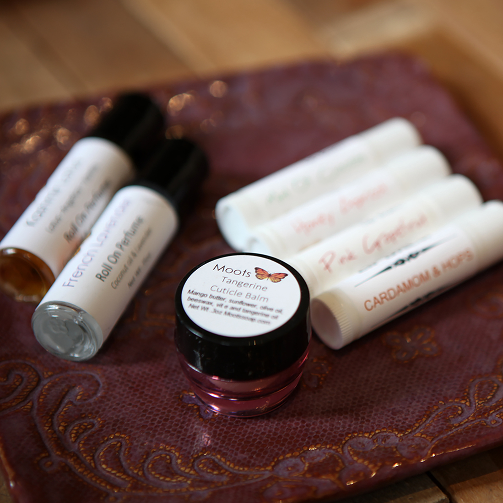 Lip Balms, $4.  Cuticle balm, $6. Roll on Perfume, $12.