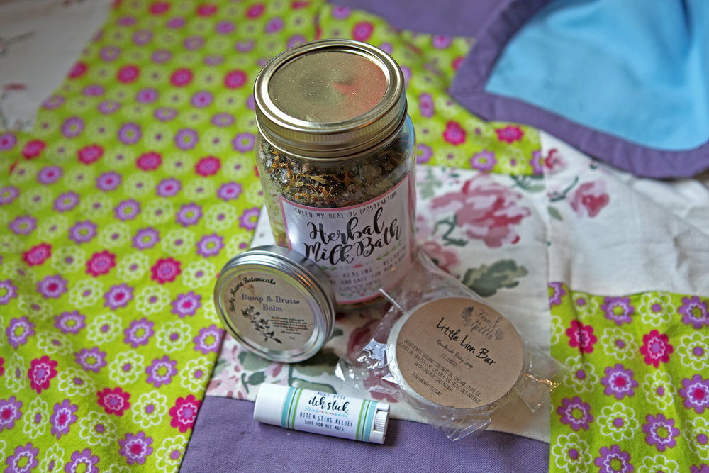 Milk Bath  and Itch Stick by Wandering Mom, $5-$17. Bump and Bruise balm by Baby Momma Botanicals, $12, Little Lion Bar by Fern and Nettle, $6.