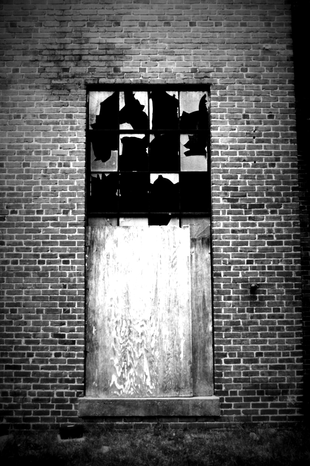 broken and boarded window lomo.jpg