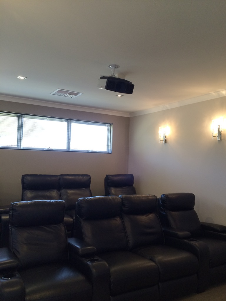 The literal home theatre room filled with Lay-z-boys deserves a couple of photos.  Not art, but still weird.