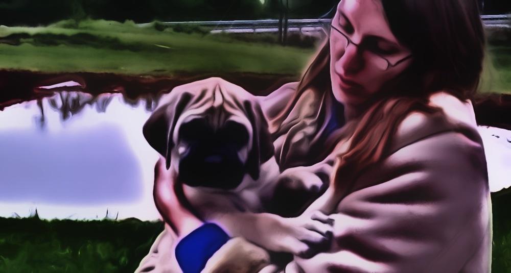 Holding Clara's pup.jpg