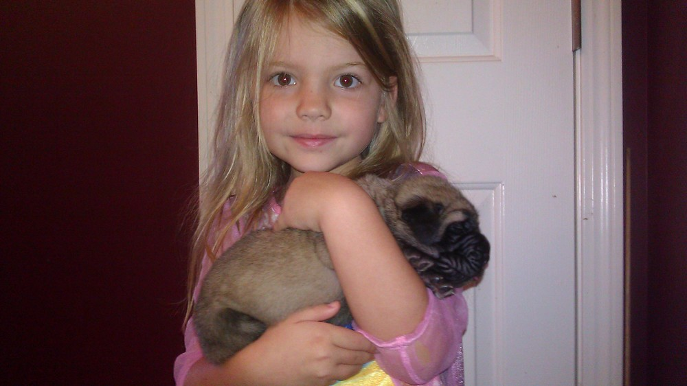 Leah holding Topez 2012 2 wk old pup.jpg