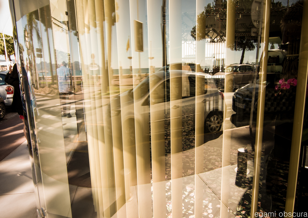Reflection through a shop window in Cannes