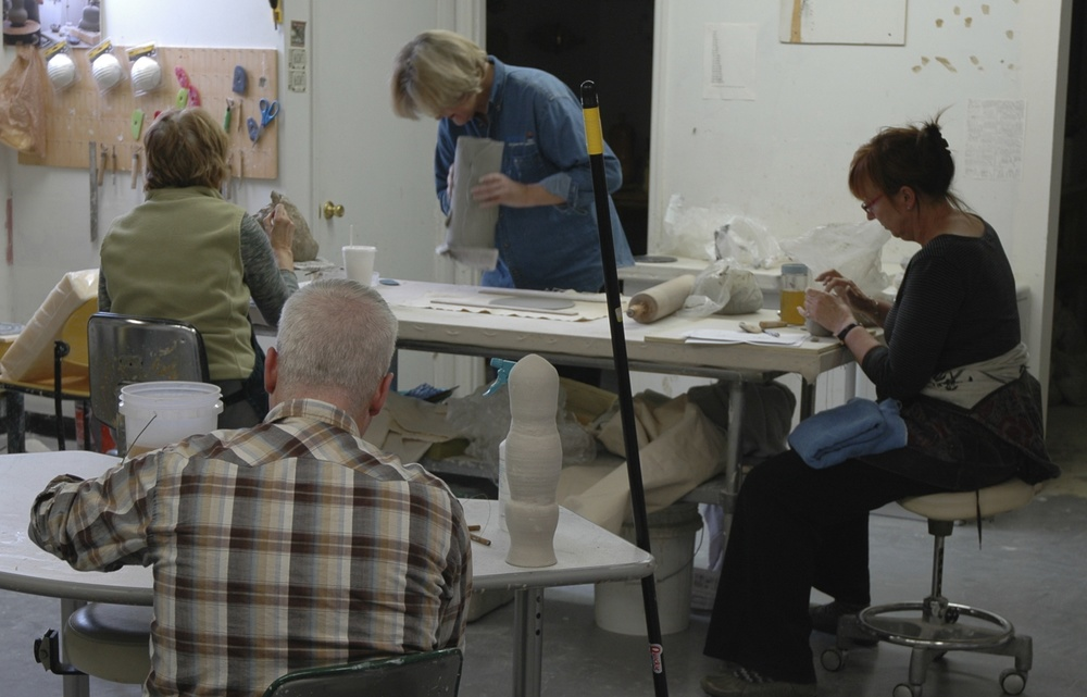 Hand-building in the clay room. We do teach brand new beginners, but 3 of the people shown have advanced degrees in art.