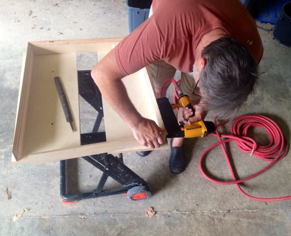 Scott is building Dori's frames for the upcoming DECADE 10th Anniversary exhibit at Red Dot. He loves his outdoor wood shop in the Alabama summer heat.