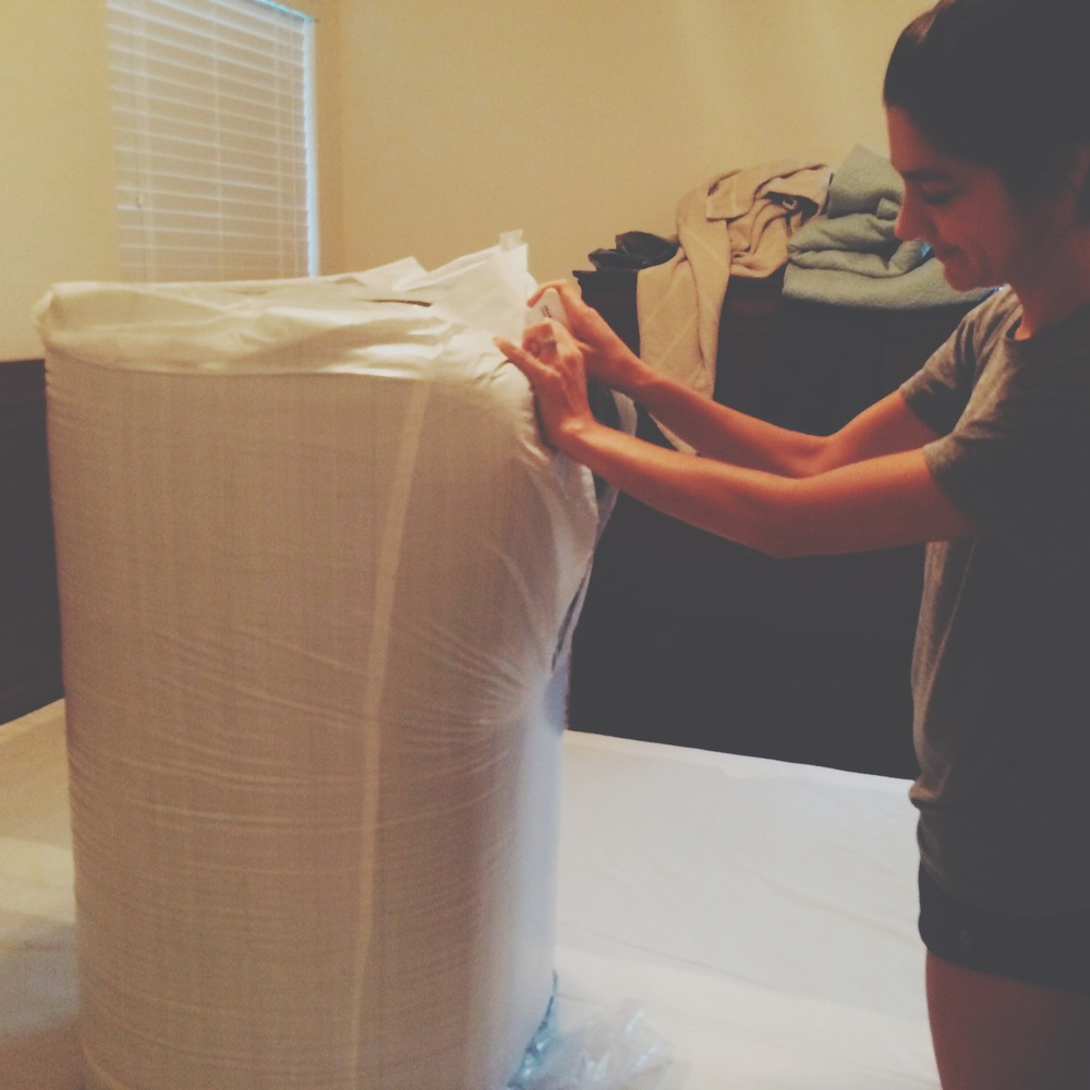 My wife, doing the honors of unpacking the new Casper