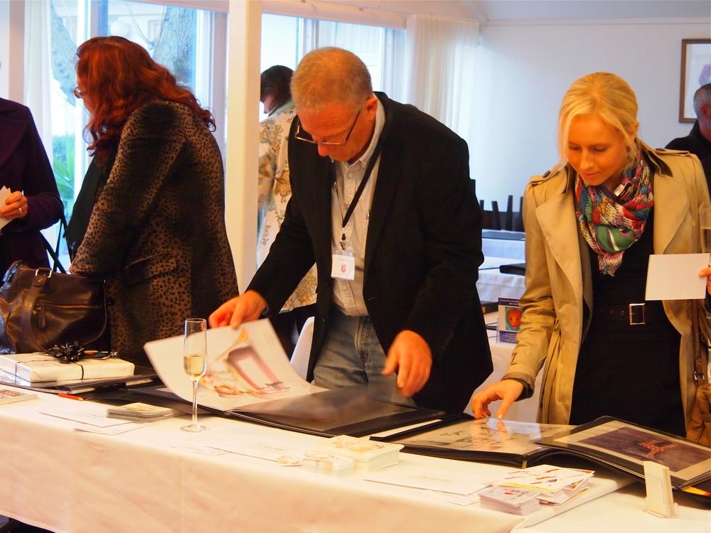 Publishers pore over illustrators portfolio, 2012 Aus/NZ Conference
