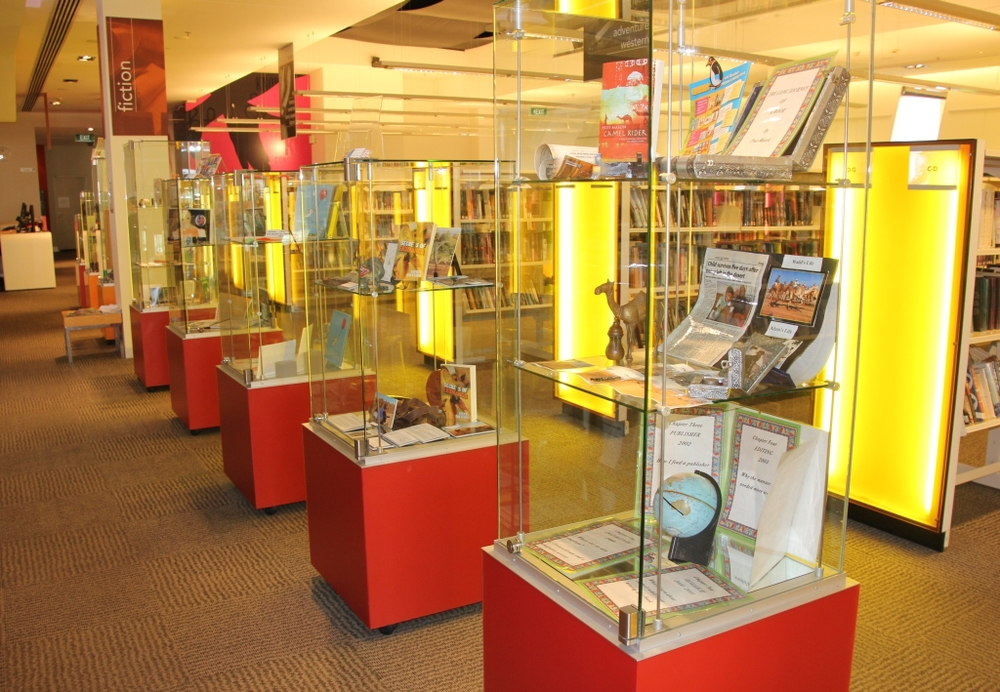 Part of the  SCBWI Qld exhibition in the Brisbane City Library in George Street. Featuring author display cases and illustrators' images on both side walls.