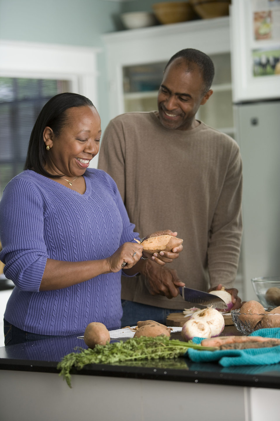 16280-an-african-american-couple-preparing-a-healthy-meal-pv.jpg