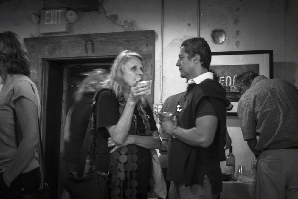 Photographers Sylvia Plachy and Ernesto Bazan chatting at the Whiskey Bonding barn reception.
