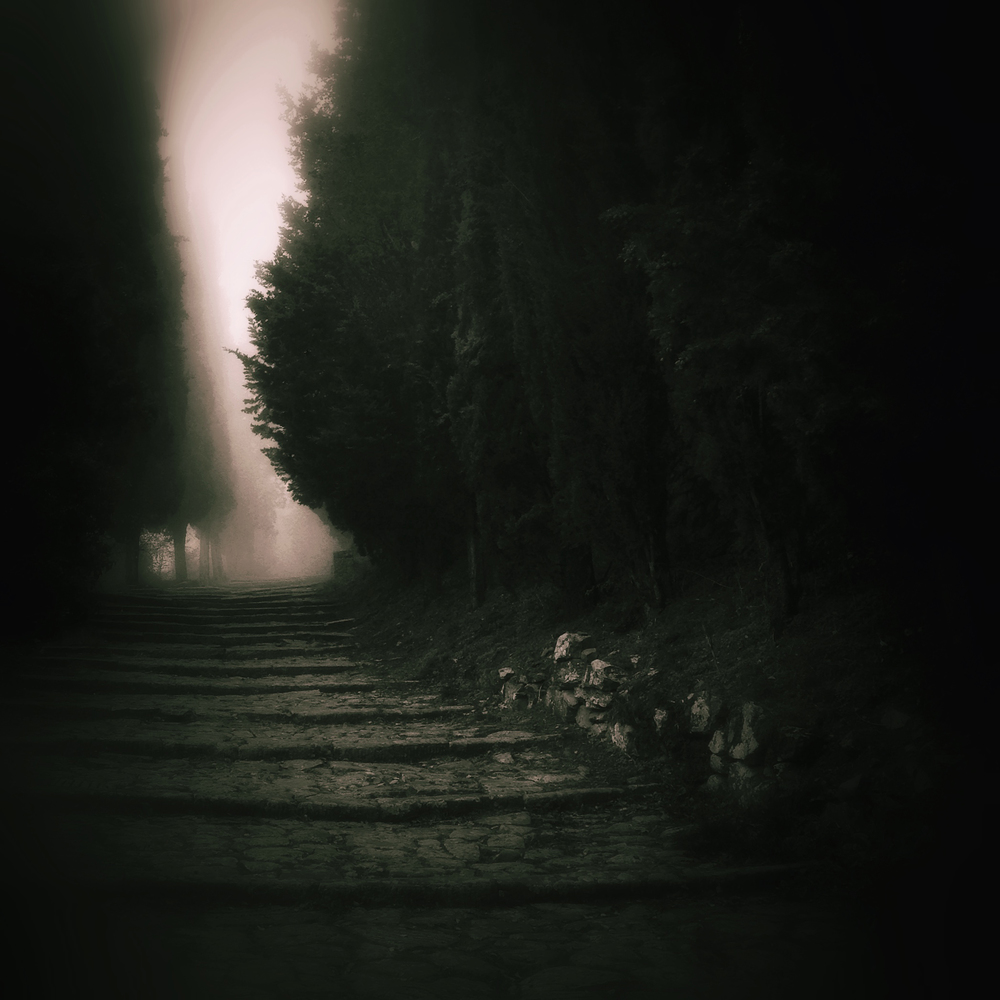 A path leading through the fog to the top of Cortona, an ancient hill town in Tuscany, Italy.