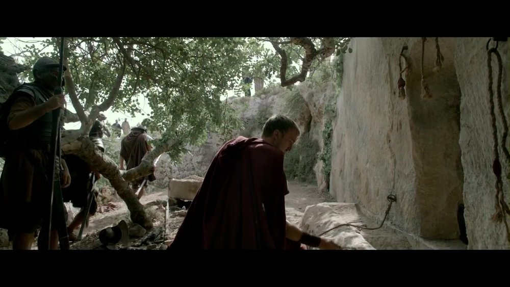 "Joseph Fiennes as Roman Tribune Clavius inspecting the empty tomb of Christ in the movie ""Risen."""