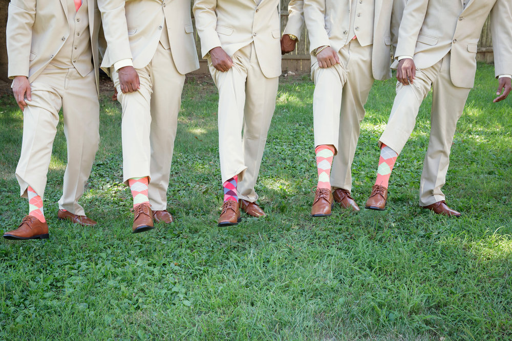 I loved the color scheme of this wedding. The guys were quite proud of their patterned socks! It was a nice touch.