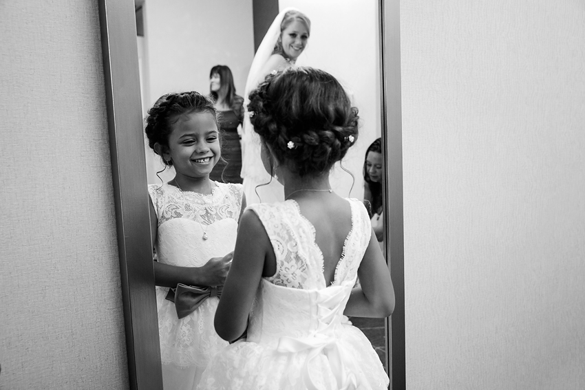 I love a good mirror shot. This little flower girl looks and feels like a princess. I love her mom, the bride, looking on as they wrap up their finishing touches.