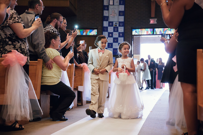 The ring bearer and flower girl are brother and sister. So cute!
