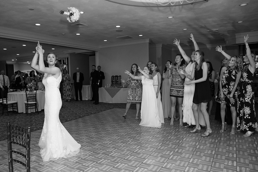 Last year was not a big year for the bouquet and garter toss. I was afraid it was becoming a lost tradition. I was so happy to see it on my shot list for this wedding.