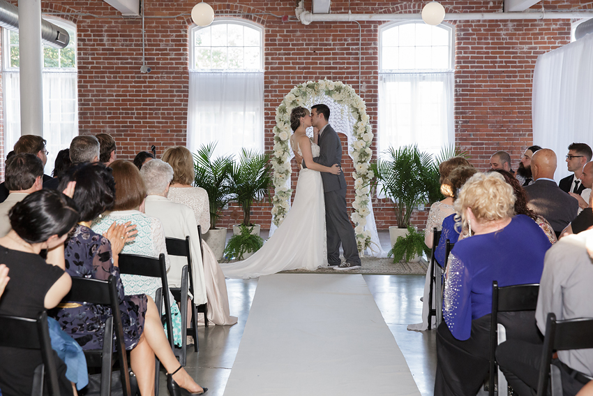 Gorgeous, industrial venue. Perfect for this couple. Hope Artiste Village, Pawtucket, RI